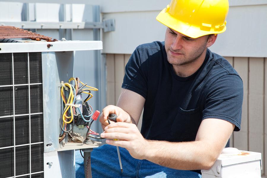 man fixing the AC unit